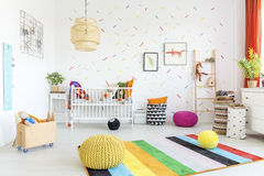 Baby room with white wall. And light wooden furniture royalty free stock photos