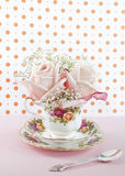Baby roses in a cup Royalty Free Stock Images