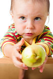Baby with the rotten apple. Royalty Free Stock Image