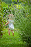 Baby running in the garden. Out of focus back of a little toddler running in the garden Royalty Free Stock Photography