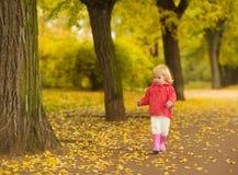 Baby running in park Stock Photo