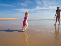 Baby running at shore to mother Royalty Free Stock Photography