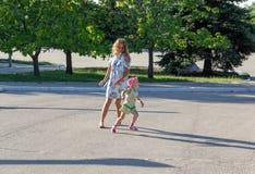 Baby runs away from mom. Mom runs for the child stock photo