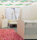 Baby's bedroom in pastel colors Stock Image