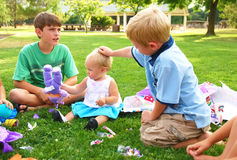 Baby's Birthday Party. Little boy pats a birthday girl's head Royalty Free Stock Images