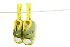 Baby�s bootee. Green baby�s bootee hanging on the clothesline Stock Photo