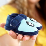 Baby's bootee. On a palm of future mum Stock Photos
