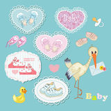 Baby's bootees. In blue and pink frame Royalty Free Stock Image