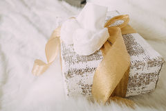 Baby's bootees on the Cristmas gift Stock Photography