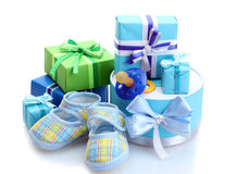 Baby's bootees and dummy. Beautiful gifts, baby's bootees and dummy over the white Stock Photos
