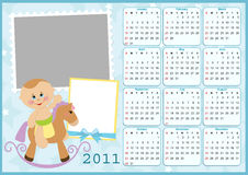 Baby's calendar for 2011. Baby's calendar for year 2011 with photo frames Royalty Free Stock Image