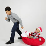 Baby's Christmas Ride Stock Photos