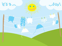 Baby's clothes drying under the sun Royalty Free Stock Images