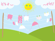Baby's clothes drying under the sun Royalty Free Stock Photo