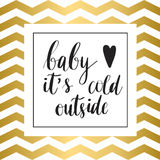 Baby it s cold outside  print. Baby it s cold outside. Christmas holiday  print. Black lettering hand written text on gold and white zig zag background Stock Image