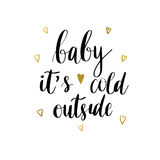 Baby it s cold outside  print. Baby it's cold outside. Christmas holiday  print. Black lettering hand written text on white background with golden hearts Royalty Free Stock Photography