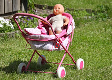 Baby's doll in a carriage Royalty Free Stock Photo