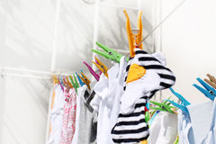 Baby's drying laundry Stock Photo