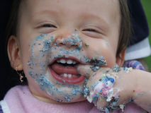 Baby's face with cake. All over it Royalty Free Stock Images