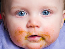 Baby with food on face Royalty Free Stock Photo