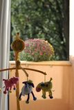 Baby's farm. A toy carrousel in baby's room royalty free stock photos