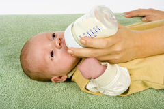 Baby's feeding Royalty Free Stock Photos