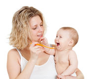 Baby's feeding by spoon. Baby eating with help of spoon Stock Photos