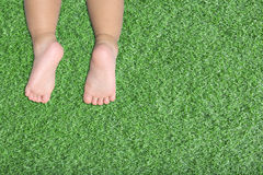 Baby's feet on artificial turf Royalty Free Stock Photography
