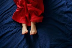 Baby`s feet on the bed stock photos