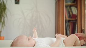 Baby`s Feet in Mother`s Hands. Baby`s feet in his mother`s hands, in bed at home. Long shot stock video footage