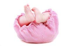 Baby's feet over white Stock Image