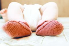 Baby's feet in pink socks Stock Images