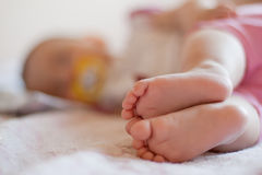 Baby's feet;. Baby sleep on its side. Feet in distinctly and close up Royalty Free Stock Photos