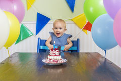Baby's first birthday party. Super cute baby blowing her first birthday candle Royalty Free Stock Photo