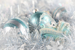 Baby's First Christmas (blue). Pale blue ornaments with one special one that signifies a special first for baby stock photo
