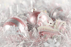 Baby's First Christmas (pink). Pale pink ornaments with one special one that signifies a special first for baby stock image