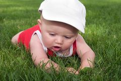 Baby's first grass experience Stock Photos