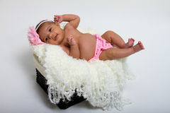 Baby's first photoshoot. Stock Photos