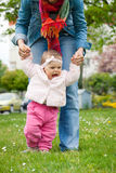 Baby's first steps Royalty Free Stock Photos