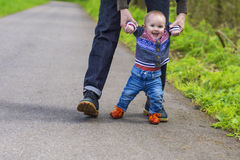 Baby's first steps royalty free stock images
