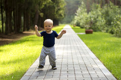 Baby`s first steps.The first independent steps. Cute boy on the walk Royalty Free Stock Images