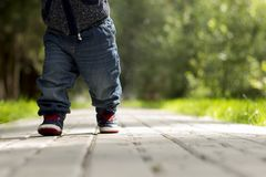 Baby`s first steps.The first independent steps. Running toddler in the park. Copy space stock photos