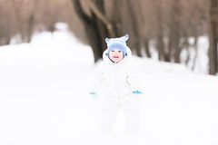 Baby's first steps in the snow Royalty Free Stock Photo