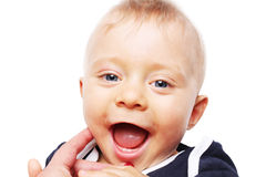 Baby's first teeth - happy boy Stock Images