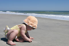 Baby's first trip to the beach Royalty Free Stock Image