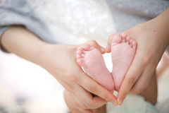 Baby's foot as love heart shape Royalty Free Stock Photo