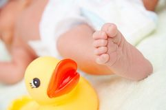 Baby's foot and toy stock images