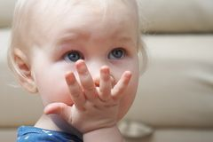 Baby's glance. Serious baby's glance Royalty Free Stock Photo
