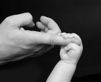 Baby's hand Stock Images