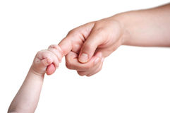 Baby's hand holding finger of mother Stock Photography